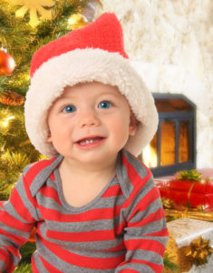 toddler boy in christmas hat